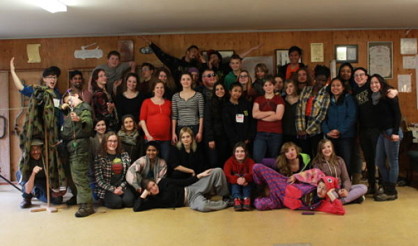 40 Youth and Adults in a group photo inside a cabin at a Top Left Conference. They are celebrating the end of the conference.