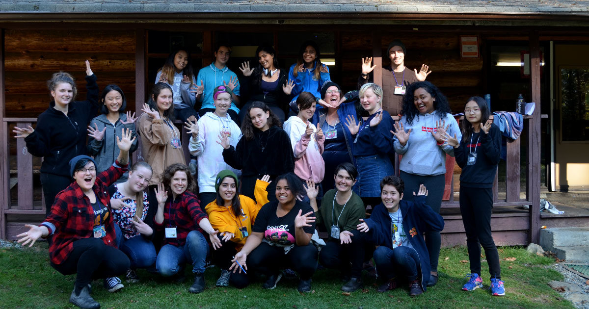20 Rhizome youth and staff in front of a cabin
